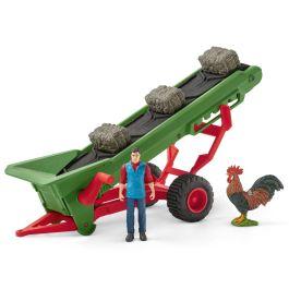 Cinta transportadora de heno con campesino