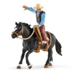 Saddle bronc riding met cowboy